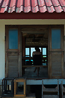 Girl through the window of Lighthouse restaurant, Phangan island, Thailand