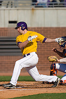 Devin Harris #34 of the East Carolina Pirates follows through on his swing versus the Virginia Cavaliers at Clark-LeClair Stadium on February 20, 2010 in Greenville, North Carolina.   Photo by Brian Westerholt / Four Seam Images