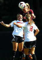 WINSTON-SALEM, NORTH CAROLINA - August 30, 2013:<br />  Nicole Mitchell (4) and Erin Yenney (16) of Louisville University lose a header to Ellie Zoepfl (7) of Virginia Tech during a match at the Wake Forest Invitational tournament at Wake Forest University on August 30. The game ended in a 1-1 tie.