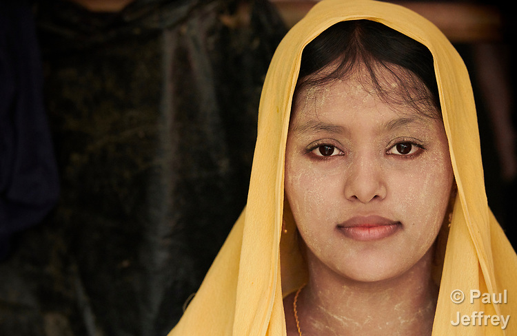 Zano Begum in her makeshift shelter in the Chakmarkul Refugee Camp near Cox's Bazar, Bangladesh. Begum arrived in the sprawling camp one month earlier. She has thanaka on her face, a cosmetic common in parts of Myanmar. <br /> <br /> More than 600,000 Rohingya refugees have fled government-sanctioned violence in Myanmar for safety in this and other camps in Bangladesh.