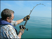 BNPS.co.uk (01202 558833)<br /> Pic: Graeme Pullen/BNPS<br /> <br /> ***Must use full byline***<br /> <br /> Graeme's rod is nearly bent double as he battles the monster fish.<br /> <br /> Never mind the pollocks...<br /> <br /> This is the jaws-dropping moment an angler fishing for pollock hooked a whopping 450lbs shark less than a mile from a holiday beach.<br /> <br /> Graeme Pullen was making the most of a large shoal of the small white fish close to the north Devon coast when the 8ft long shark took his bait.<br /> <br /> Graeme shouted to friend Wayne Comben 'never mind the pollocks' as his rod bent over double and he began an almighty 30 minute fight to reel in the monster catch in.