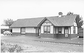 D&amp;RGW Farmington depot with 1938 Oldsmobile parked nearby.<br /> D&amp;RGW  Farmington, NM  ca. 1940