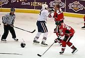 February 22nd 2008:  Matt Carkner (22) of the Binghamton Senators fights Anthony Stewart (24) of the Rochester Amerks as linesman Michael Baker, and Lawrence Nycholat (28) move equipment at Blue Cross Arena at the War Memorial in Rochester, NY.  The Senators defeated the Amerks 4-0.   Photo copyright Mike Janes Photography