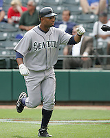 Seattle Mariners OF Wladimir Balentien celebrates scoring the winning run in the 12th inning against the Texas Rangers on May 14th, 2008 at Texas Rangers Ball Park. Photo by Andrew Woolley / Four Seam Images.