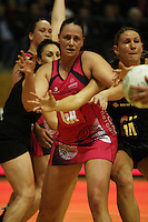 World goal attack Megan Dehn calls for a pass under pressure from Casey Williams during the International  Netball Series match between the NZ Silver Ferns and World 7 at TSB Bank Arena, Wellington, New Zealand on Monday, 24 August 2009. Photo: Dave Lintott / lintottphoto.co.nz