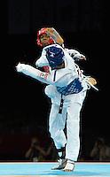 Lutalo Muhammad (GBR) (L) fights Farkhod Negmatov (TJK).Taekwondo.ExCel Arena.Olympics 2012.London UK. .10/08/12,.photo: Sean Ryan / IPS Photo Agency.. mobile: 07971 400 939.Address: Thatched Cottage,Wretham,Thetford, Norfolk IP24 1RH .Office tel: 01953 499 403...
