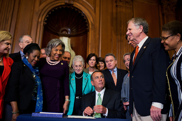 UNITED STATES - MAY 21: Speaker John Boehner, R-Ohio, looks at Rep. Ted Poe, R-Texas, during a bill signing ceremony with other members in the Capitol's Rayburn Room for the Justice for Victims of Trafficking Act, May 21, 2015. (Photo By Tom Williams/CQ Roll Call)