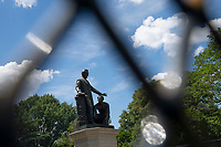 The Emancipation Memorial is seen through additional fencing at Lincoln Park in Washington D.C., U.S. on Monday, June 29, 2020.  Many demonstrators have called for the removal of the statue in recent weeks.  Credit: Stefani Reynolds / CNP /MediaPunch