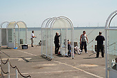 Men fishing on Clacton Pier.  The resort is the second most deprived seaside town in the UK.