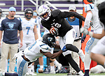 SIOUX FALLS, SD - OCTOBER 27: Anthony Holmes #18 from the University of Sioux Falls makes a move against Terrell Powell #3 from Upper Iowa during their game Saturday at Bob Young Field in Sioux Falls. (Photo by Dave Eggen/Inertia)
