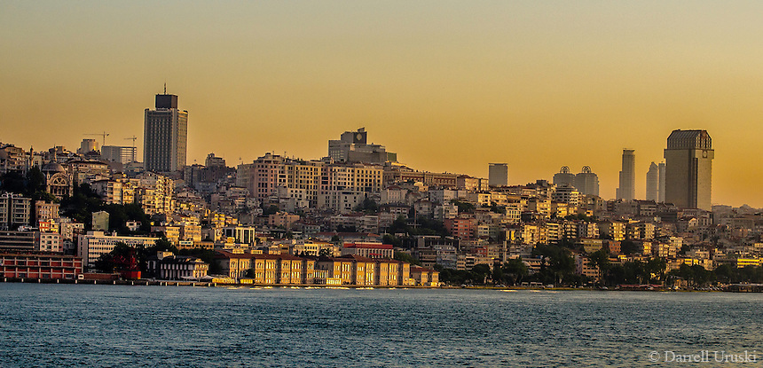 Fine Art Landscape Photograph of a golden sunset of the Bosphorus Strait and the skyline in Istanbul Turkey.