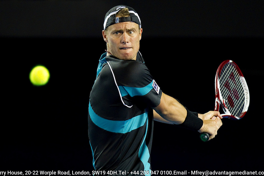 Lleyton Hewitt (AUS) against David Nalbandian (ARG) (27) in the first round of the men's singles. David Nalbandian beat Lleyton Hewitt 3-6 6-4 3-6 7-6 9-7.... ..... .International Tennis - Australian Open  -  Melbourne Park - Melbourne - Day 1 - Mon 17th January 2011..© Frey - AMN Images, Level 1, Barry House, 20-22 Worple Road, London, SW19 4DH.Tel - +44 208 947 0100.Email - Mfrey@advantagemedianet.com.Web - www.amnimages.photshelter.com