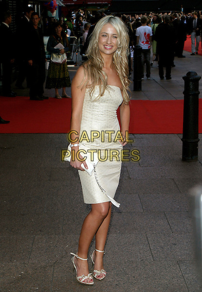 "CHANTELLE HOUGHTON.""Superman Returns"" UK film premiere, Odeon Leicester Square, London, UK..July 13th, 2006.ReF: AH.full length white strapless dress hand on hip clutch purse.www.capitalpictures.com.sales@capitalpictures.com.© Capital Pictures."