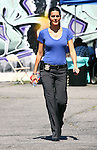 Apr 16th 2012 ..Angie Harmon filming her tv show Rizzoli & Isle. Angie was wearing a tight blue t shirt police badge playing her roll as a cop while filming in Los Angeles. .Laughing smiling playing & petting a dog on the set. Angie was carrying a Louis Vuitton folder ...www.AbilityFilms.com.805-427-3519.AbilityFilms@yahoo.com.