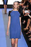 mina walks runway in a cyan blue crepe dress with leather cap sleeve, by Monique Lhuillier, from the Monique Lhuillier Spring 2012 collection fashion show, during Mercedes-Benz Fashion Week Spring 2012.