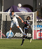 Todd Dunivant of Galaxy battles for the ball in the air away from Simon Dawkins of Earthquakes during the game at Buck Shaw Stadium in Santa Clara, California on October 21st, 2012.  San Jose Earthquakes and Los Angeles Galaxy tied at 2-2.