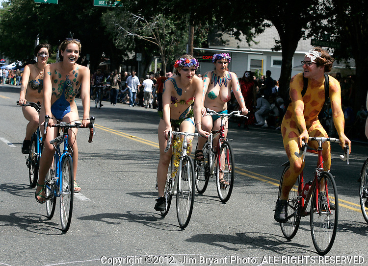 Painted nude bicyclists  ride during the 25th  Annual Fremont Summer Solstice Parade in Seattle on June 22, 2013.     ©2013. Jim Bryant. ALL RIGHTS RESERVED.Painted nude bicyclists  ride during the 25th  Annual Fremont Summer Solstice Parade in Seattle on June 22, 2013.     ©2013.  Jim Bryant.  ALL RIGHTS RESERVED.