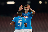 Calcio, Champions League Gruppo B: Napoli vs Benfica. Napoli, stadio San Paolo, 28 settembre 2016. <br /> Napoli's Arkadiusz Milik, right, celebrates with his teammate Allan after scoring on a penalty kick during the Champions League Group B soccer match between Napoli and Benfica at the Naples' San Paolo stadium, 28 September 2016. Napoli won 4-2.<br /> UPDATE IMAGES PRESS/Isabella Bonotto