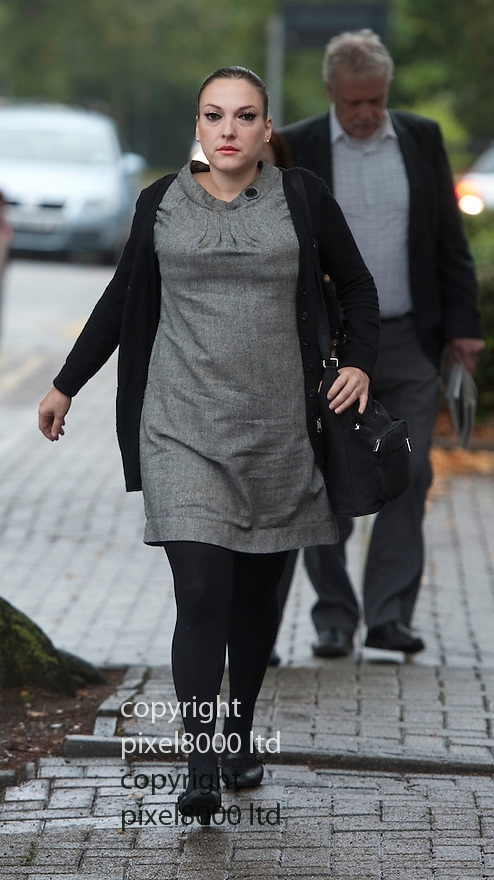 Justin Lee Collins trial today. His former girlfriend Anna Larke arrives for the trail in grey dress....Pic by Gavin Rodgers/Pixel 8000 Ltd 1.10.12