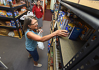 NWA Democrat-Gazette/FLIP PUTTHOFF <br /> GROCERIES TO GO<br /> Pam Heckerson (left) and Xiomara Escobar fill orders on Tuesday July 9 2019 at the Grace United Methodist Church food pantry in Rogers. Free food and personal hygeine items are available on Tuesdays and Thursdays from 9 to 11:45 a.m. at the church, located at 1801 S. Dixieland Road.