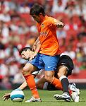 Inter Milan's Julio Cruz tackled by Valencia's David Silva.Pic SPORTIMAGE/Simon Bellis