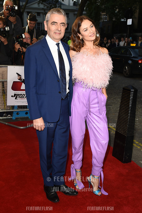 LONDON, UK. October 03, 2018: Olga Kurylenko &amp; Rowan Atkinson at the premiere of &quot;Johnny English Strikes Again&quot; at the Curzon Mayfair, London.<br /> Picture: Steve Vas/Featureflash