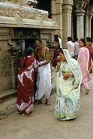 Women greeting a Hindu priest outside the famous Sri Ranganathaswamy Temple, Tiruchirappalli, Tamil Nadu, India.