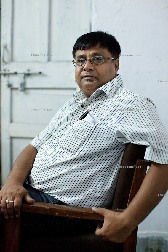 Dr. Shirish Jain, Deputy Chief Medical Officer (CMO) of the Ghaziabad District, sits for a portrait in his office in * Ghaziabad, Uttar Pradesh, India. Photo by Suzanne Lee / Panos London