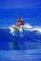 Woman surfing on the south shore of Maui