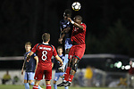 CARY, NC - SEPTEMBER 29: UNC's Jelani Pieters (left) and NC State's Tater Rennhack (9) challenge for a header. The University of North Carolina Tar Heels hosted the North Carolina State University Wolfpack on September 29, 2017 at Koka Booth Field at WakeMed Soccer Park in Cary, NC in a Division I college soccer game.