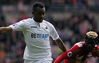 Jordan Ayew of Swansea City (L)  in action during the Premier League match between Sunderland and Swansea City at the Stadium of Light, Sunderland, England, UK. Saturday 13 May 2017