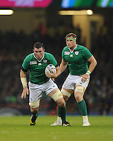 Peter O'Mahony of Ireland in action as Jamie Heaslip of Ireland looks on during Match 39 of the Rugby World Cup 2015 between France and Ireland - 11/10/2015 - Millennium Stadium, Cardiff<br /> Mandatory Credit: Rob Munro/Stewart Communications