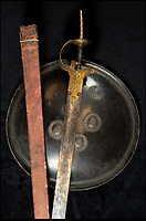 BNPS.co.uk (01202) 558833<br /> Pic: PhilYeomans/BNPS<br /> <br /> Tipu Sultan's sword complete with its wood and silk scabbard and a Mysorian laquered shield.<br /> <br /> Stunning artefacts from Indian hero Tipu Sultan's fateful last stand have been rediscovered by the family of an East India Company Major who took part in the famous battle that ended his reign.<br /> <br /> And now Major Thomas Hart's lucky descendents are likely to become overnight millionaires after retrieving the historic items from their dusty attic.<br /> <br /> The fascinating treasures were taken from Tipu's captured fortress of Seringapatam in the wake of his defeat by British forces led by a young Duke of Wellington in 1799.<br /> <br /> The cache of ornate gold arms and personal effects even include's the battle damaged musket the Sultan used in his fatal last stand against the expanding British Empire in India.<br /> <br /> Tipu was last seen on the battlements of the fortress firing his hunting musket at the advancing British and after the fierce encounter his body was found bearing many wounds, including a musket ball shot above his right eye.<br /> <br /> The rediscovered musket, complete with battle damaged bayonet, has the distinctive tiger stripe pattern unique to the self styled Tiger of Mysore own weapons - and tellingly there is also shot damage to the lock and stock that may have been caused by the musket ball that finished him off.<br /> <br /> Also included in the sale are four ornate gold-encrusted sword's bearing the mark of Haider Ali Khan, Tipu's father and the previous ruler of independent Mysore, along with a solid gold &lsquo;betel casket&rsquo; complete with three 220 year old nuts still inside.<br /> <br /> The war booty was brought back to Britain by Major Thomas Hart of the British East India Company following the fourth and final Anglo-Mysore war.<br /> <br /> They have been passed down through the family ever since and now belong to a couple who have kept them wrapped in newspaper in the dusty attic of their semi-detached home for years.