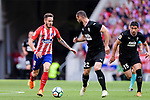 Saul Niguez of Atletico de Madrid (L) in action against David Lomban of SD Eibar (R) during the La Liga match between Atletico Madrid and Eibar at Wanda Metropolitano Stadium on May 20, 2018 in Madrid, Spain. Photo by Diego Souto / Power Sport Images