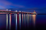 The Mackinac Bridge over the Straits of Mackinac connecting the upper and lower peninsulas of Michigan just after sunset, USA