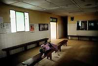 A woman is waiting for treatment in the waiting hall of the St John of God hospital in Lunsar, Sierra Leone. The hospital is one of the best in the whole country.