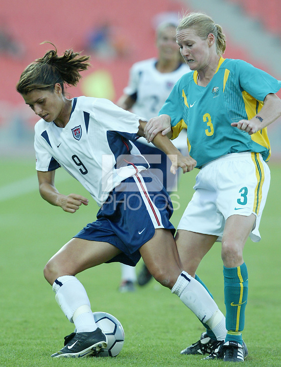 17 August 2004:  Mia Hamm battles for the ball against Sacha Wainwright during the second half of the game against Australia at Kaftanzoglio Stadium in Thessaloniki, Greece.     USA defeated Australia, 0-0.   Credit: Michael Pimentel / ISI