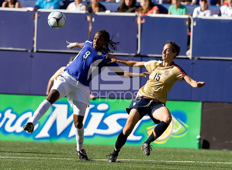 Katia holds off Kate Markgraf to trap the ball. USA defeated Brazil 2-0 at Giants Stadium on Sunday, June 23, 2007.