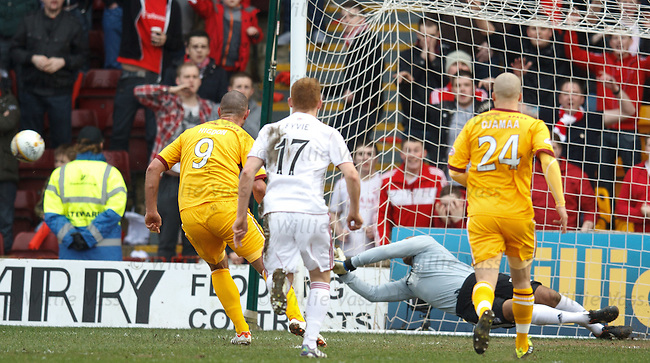 Jason Brown pushes away Michael Higson's penalty kick