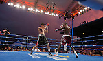 Luis Grajeda from Chihuahua, Mexico, left, fights Willie Nelson from Cleveland, Ohio at sunset during the Light Middleweight main event of the Rural Rumble on Friday night, August 8, 2014 at Churchill County Fairgrounds in Fallon, Nevada.