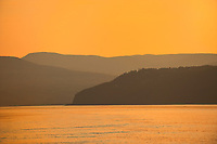 St. Lawrence River a sunset. Cote Nord (North Shore)., L'Isle-aux-Coudres, Quebec, Canada
