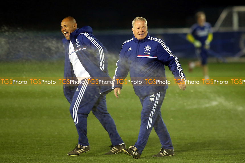 Chelsea manager, Dermot Drummy sees the funny side as the sprinklers are turned on just as he walks across the pitch prior to kick-off - Chelsea Under-21 vs Blackburn Rovers Under-21 - Barclays Under-21 Premier League Football at Cobham - 28/03/14 - MANDATORY CREDIT: Paul Dennis/TGSPHOTO - Self billing applies where appropriate - 0845 094 6026 - contact@tgsphoto.co.uk - NO UNPAID USE