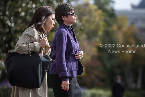 Nancy-Ann DeParle, Deputy Chief of Staff for Policy, left, and senior advisor Valerie Jarrett walk to join President Barack Obama aboard Marine One on Saturday, October 27, 2012 in Washington, DC. Obama is traveling to New Hampshire for a campaign event..Credit: Brendan Hoffman / Pool via CNP