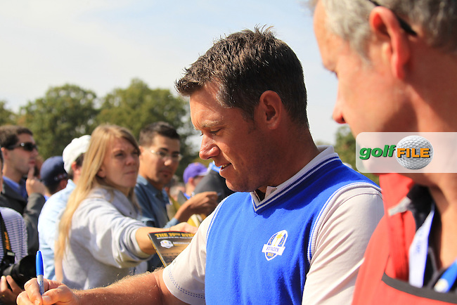 European Team player Lee Westwood (ENG) signs autographs on the way to the 5th tee during Wednesday's Practice Day of the 39th Ryder Cup at Medinah Country Club, Chicago, Illinois 26th September 2012 (Photo Eoin Clarke/www.golffile.ie)