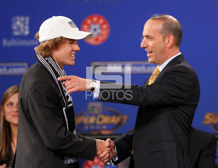 Kansas City Wizards first pick and first overall pick Chance Myers shakes hands with MLS commisioner Don Garber during the MLS SuperDraft at the Baltimore Convention Center in Baltimore, MD, on January 18, 2008.