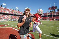 STANFORD, CA - SEPTEMBER 21: Honorary Captain Katie Ledecky shows the game coin after the coin toss during a game between University of Oregon and Stanford Football at Stanford Stadium on September 21, 2019 in Stanford, California.