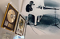 SAITAMA - DEC. 5: Gold discs in front of a large photograph of John Lennon at his famous white piano; John Lennon Museum. (Photo by Alfie Goodrich/Nippon News)