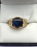 BNPS.co.uk (01202 558833)<br /> Pic: MarkThompson/BNPS<br /> <br /> A medieval ring found by a metal detectorist in the heart of Robin Hood's Sherwood Forest is tipped to sell for £50,000.<br /> <br /> Mark Thompson unearthed the gold ring in the Nottinghamshire woodland made famous by the legendary outlaw.<br /> <br /> The ring that contains a sapphire gemstone would have belonged to someone in the upper echelons of society in 15th century Sherwood.<br /> <br /> It is the sort of bling Robin Hood would have taken from the rich to give to the poor.