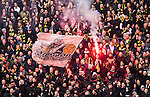 BETALBILD Solna 2015-03-07 Fotboll Allsvenskan AIK - Hammarby IF :  <br /> AIK:s supportrar med en flagga och en bengalisk eld under matchen mellan AIK och Hammarby IF <br /> (Foto: Kenta J&ouml;nsson) Nyckelord:  AIK Gnaget Friends Arena Svenska Cupen Cup Derby Hammarby HIF Bajen supporter fans publik supporters bengaler bengalisk eld eldar