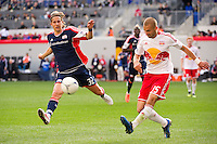 Bjorn Runstrom (32) of the New England Revolution goes for a clearance by Tyler Ruthven (15) of the New York Red Bulls. The New York Red Bulls defeated the New England Revolution 1-0 during a Major League Soccer (MLS) match at Red Bull Arena in Harrison, NJ, on April 28, 2012.